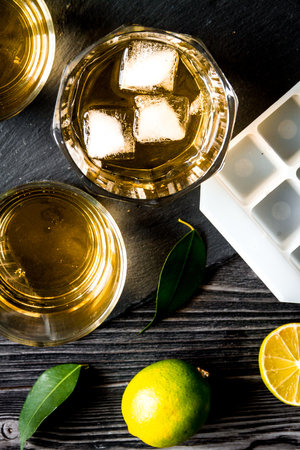 glass of scotch on dark wooden background top view close up Stock Photo