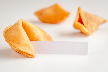 prediction: Chinese fortune cookie with prediction on white background close up Stock Photo