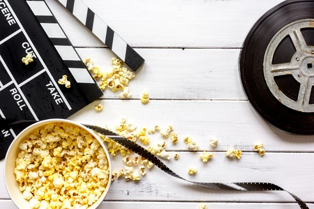 watching movie with popcorn on wooden background top view. Stock Photo