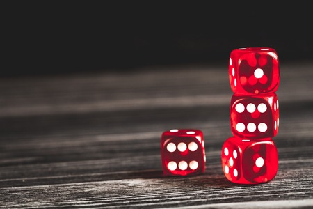 concept luck - dice gambling on dark wooden background. Stock Photo