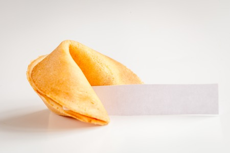 Chinese fortune cookie with prediction on white background close up Foto de archivo