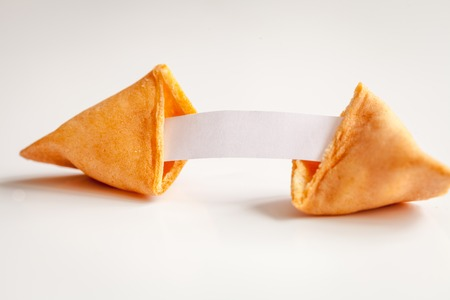 Chinese fortune cookie with prediction on white background close up Stock Photo