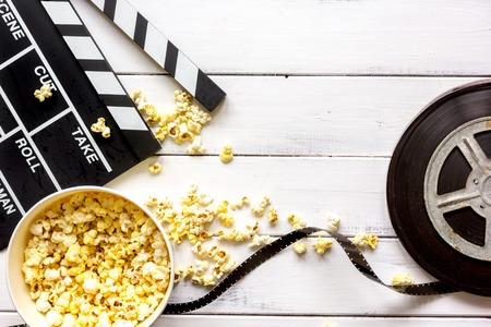 watching movie with popcorn on wooden background top view. Фото со стока