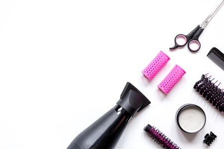 styler: preparations for styling hair on white background top view. Stock Photo