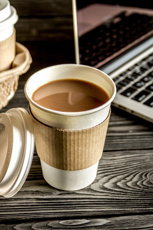 coffee cup take away at dark wooden background Stock Photo