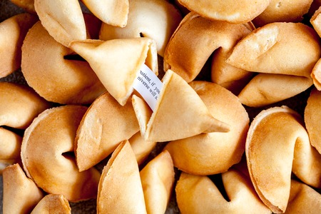 Many Chinese fortune cookie close up paper with prediction filling the entire frame Stock Photo