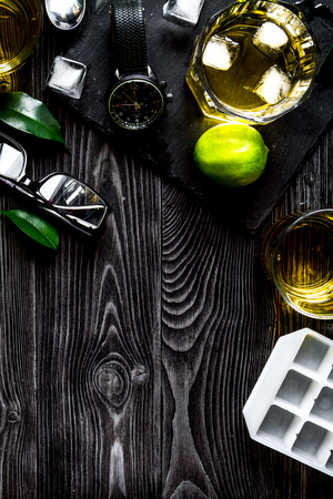 manlike: glass of scotch on dark wooden background top view. Stock Photo