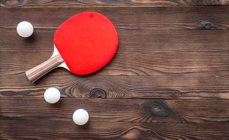 tennis racquet: tennis racquet - fitness in the wooden background top view.