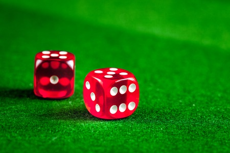playing poker dice on green background close up