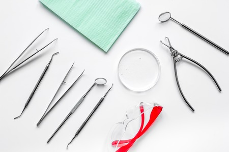 equipping: dentists tools in cabinet on white desktop top view.