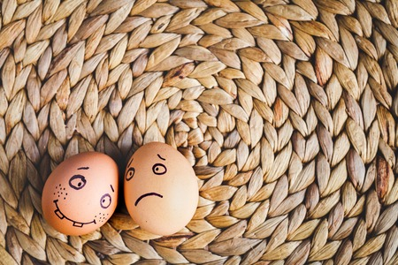 concept human relationships and emotions eggs - support on mat top view Imagens
