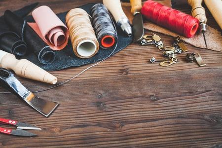 cobbler tools in workshop on wooden background mock up.