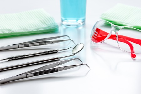 equipping: dentists tools in cabinet on white desktop close up Stock Photo