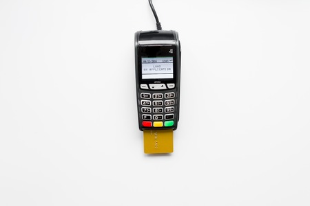 payment terminal with card on white background top view.