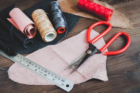 cobbler: cobbler tools in workshop on wooden background mock up.