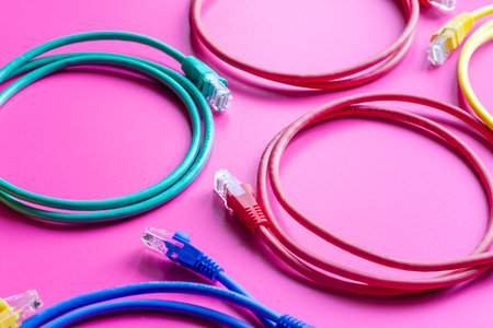 concept network internet cable on pink background close up. Stock Photo