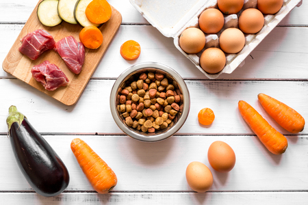 holistic view: ingredients for pet food holistic top view on wooden background. Stock Photo