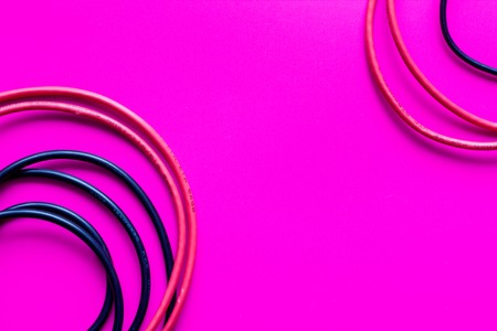 worldwideweb: concept network internet cable on pink background close up. Stock Photo