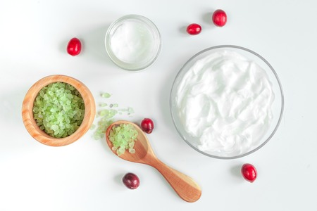 holistic view: organic cosmetics with extracts of berries on white background top view Stock Photo