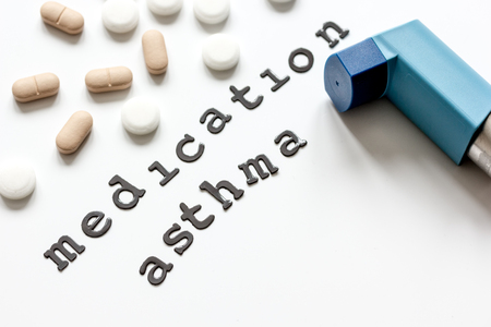 inhalation: concept asthma and treatment on white background top view. Stock Photo