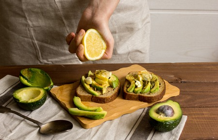 making sandwiches with avocado healthy organic food.