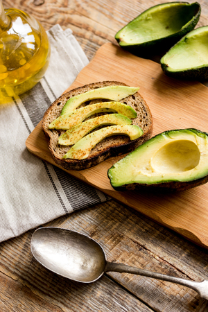making sandwiches with avocado healthy organic food top view Stock Photo