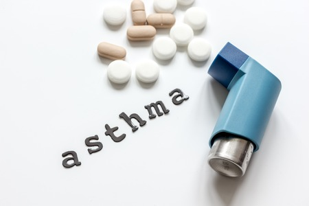 concept asthma and treatment on white background top view