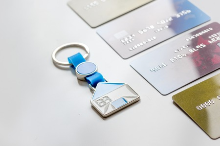 credit cards, key ring - concept mortgage on white background Stock Photo