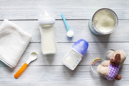 preparation of mixture baby feeding on wooden background top view 写真素材