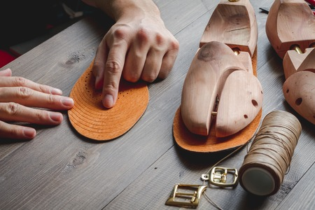 cobbler: cobbler tools in workshop dark background close up Stock Photo