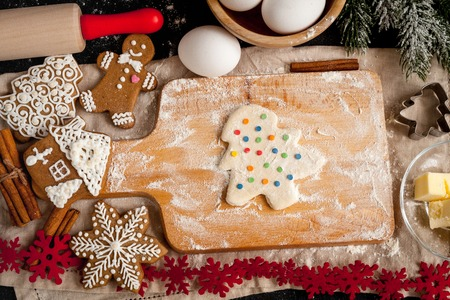dragees: cooking christmas gingerbread on wooden background top view Stock Photo