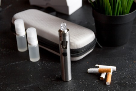 electronic background: concept of electronic cigarette on dark background Stock Photo