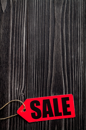 hang up: concept of sale on dark wooden background top view