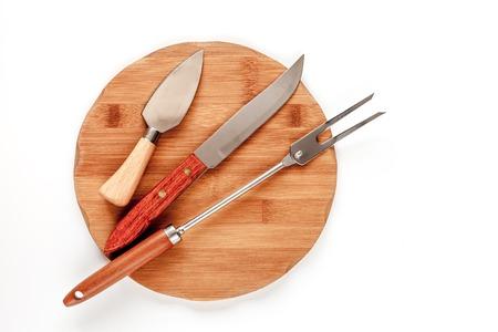 grunge cutlery: wooden kitchen utensils on white wooden background top view