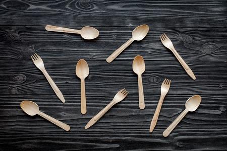 grunge cutlery: wooden kitchen utensils on dark wooden background top view pattern Stock Photo