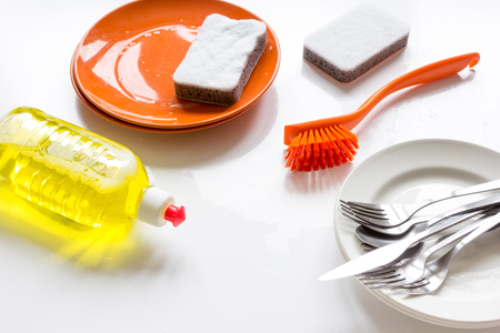 concept of washing dishes on white background close up Stock Photo