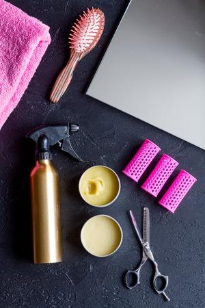 hairdresser working desk preparation for cutting hair top view on dark background