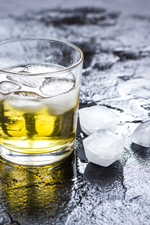 glass of whiskey on dark background close up