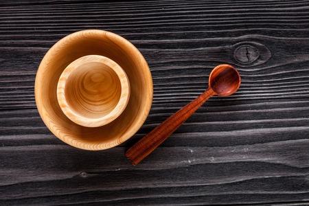 grunge cutlery: wooden kitchen utensils on dark background top view Stock Photo