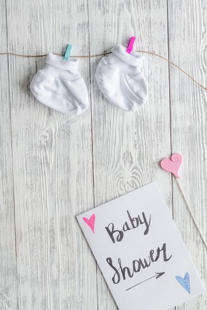 birth of child - baby shower concept on wooden background