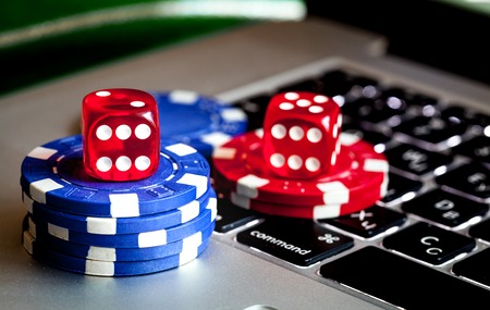 stack of chips to play poker on keyboard close up Stock Photo