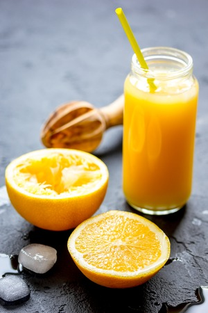 freshly squeezed orange juice on dark background close up Stock Photo