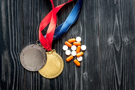 Concept of doping in sport - deprivation medals top view