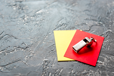 red and yellow cards on dark background close up Stock Photo