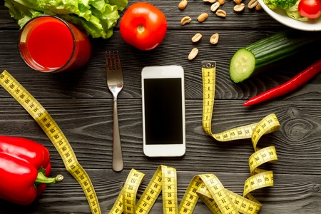 concept diet and smartphone with vegetables mock up