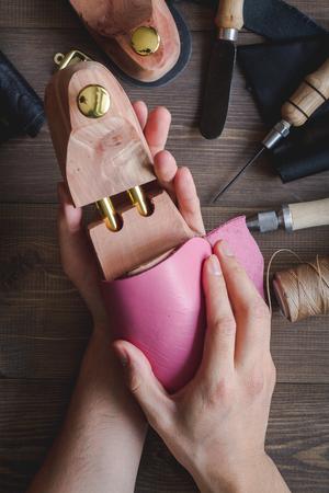 cobbler tools in workshop dark background top view Stock Photo