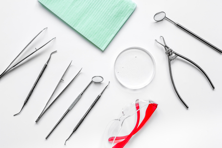 dentists tools in cabinet on white desktop top view.
