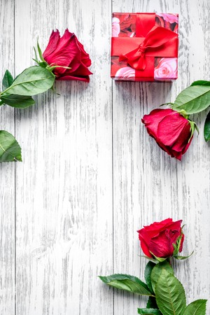 concept Valentines Day with flower wooden background top view