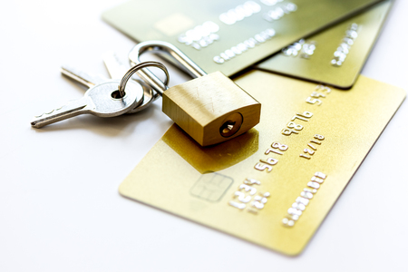 bank robber: Credit cards with lock close up - online shopping on white background