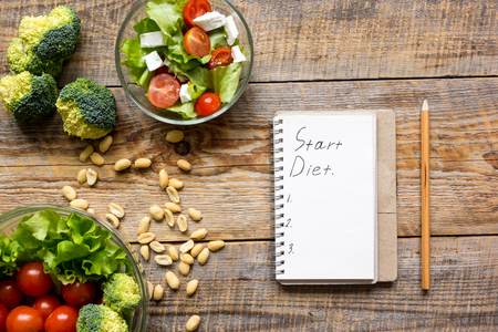 concept diet and slimming plan with vegetables top view mock up Stock Photo